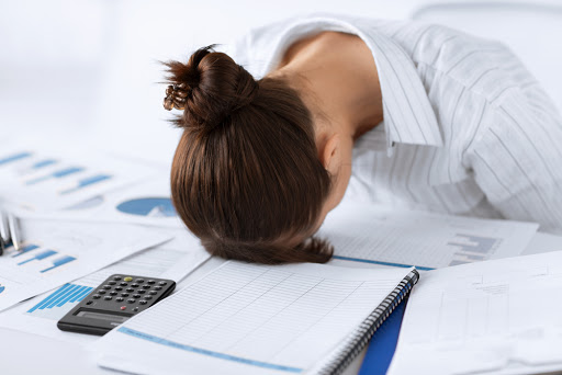 picture of woman sleeping at work in funny pose - it