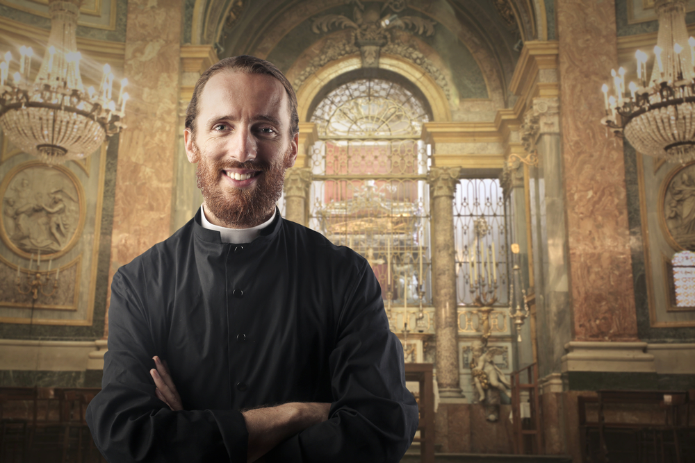 smiling priest in a church