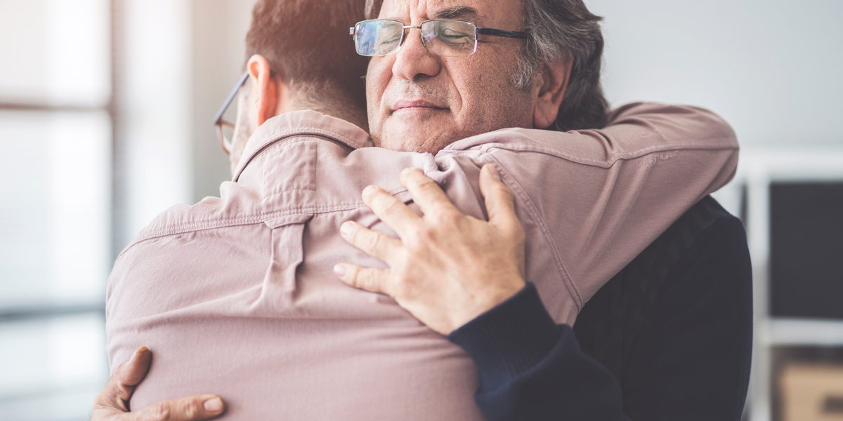 son hugs father